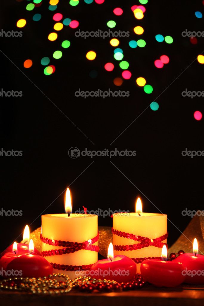 Beautiful candles on wooden table on bright background — Stock Photo #9606323