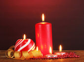 Wonderful candles on wooden table on dark background — Stock Photo