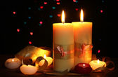 Beautiful candle and decor on wooden table on bright background — Stockfoto