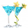 Blue cocktail in martini glasses with ice isolated on white — Stock Photo #9658845