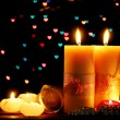 Beautiful candle and decor on wooden table on bright background — Stock Photo #9659092