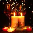 Beautiful candle and glasses of wine on wooden table on bright background - Foto de Stock