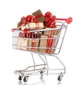 Beautiful golden gifts with red ribbon in shopping cart isolated on white — ストック写真