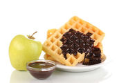 Tasty waffles with chocolate on plate isolated on white — Stock Photo