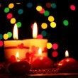 Beautiful candles on wooden table on bright background — Photo