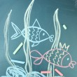 Two fishes, сhild's drawing with chalk — Stock Photo #9662092