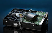 Hard disk drive on chain on dark blue background — Stock Photo