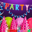Party items on purple background — Foto Stock