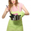 Beautiful young housewife with a pan and spoon isolated on white — Stock Photo