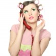 Beautiful young housewife with red telephone isolated on white — Stock Photo