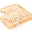 Bitten slice of wheat bread isolated on white — Stock Photo