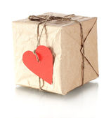 Small parcel with blank heart-shaped label isolated on white — Stock Photo