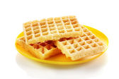 Sweet waffles on plate isolated on white — Stock Photo