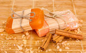 Hand-made natural soaps on wooden mat — Foto de Stock