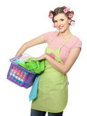 Beautiful young housewife with basket of folded laundry isolated on white — Stock Photo