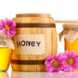 Sweet honey in barrel and jars with drizzler isolated on white — Stock Photo #9694437