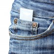 Condom in the pocket of blue jeans on white — Stock Photo #9695002