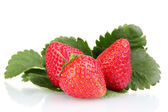 Sweet strawberries with leaves isolated on white — Stock Photo
