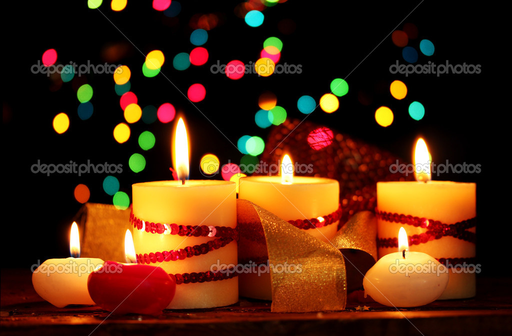 Beautiful candles on wooden table on bright background — Stock Photo #9694248