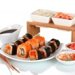 Delicious sushi on plate, chopsticks, soy sauce, fish and shrimps isolated on white — Stock Photo
