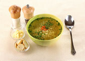 Tasty chicken stock with noodles on beige tablecloth — Foto de Stock
