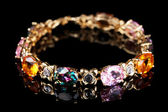 Beautiful bracelet with precious stones on black background — Stock Photo