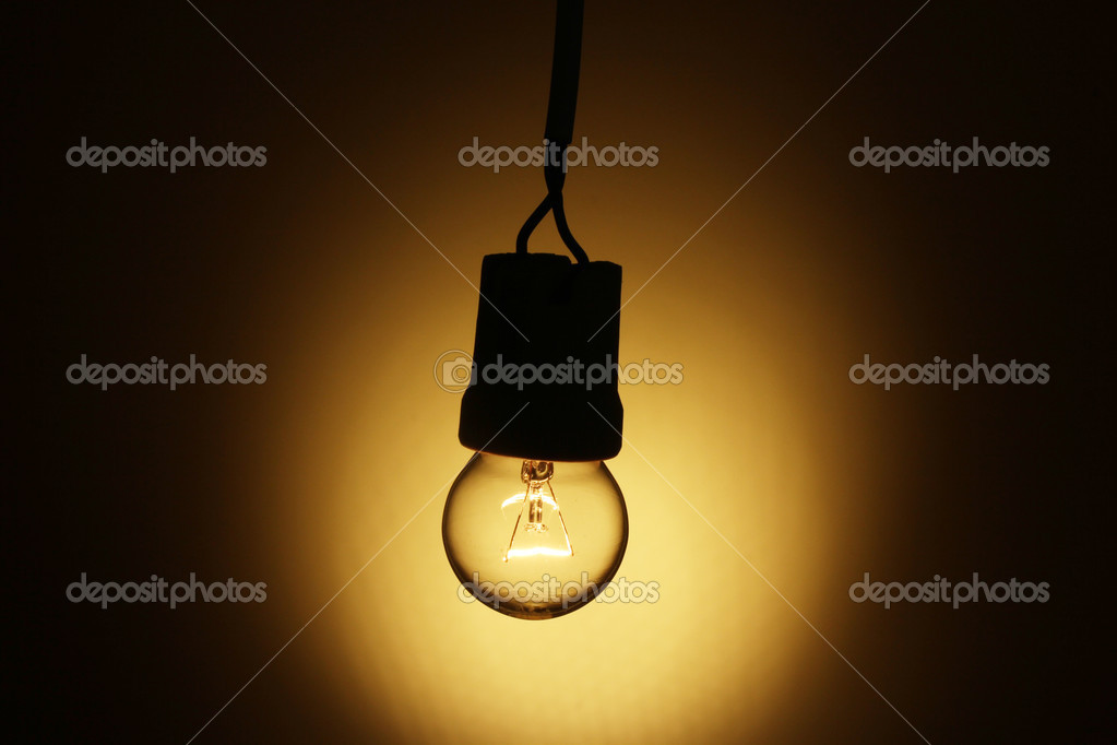 A lit light bulb on yellow background — Stock Photo #9716522