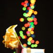 Open gift box with bokeh background on black — Lizenzfreies Foto