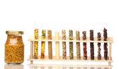 Varias especias en tubos y botella de mostaza aislado en blanco — Foto de Stock