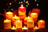 Wonderful candles on wooden table on bright background — Stok fotoğraf