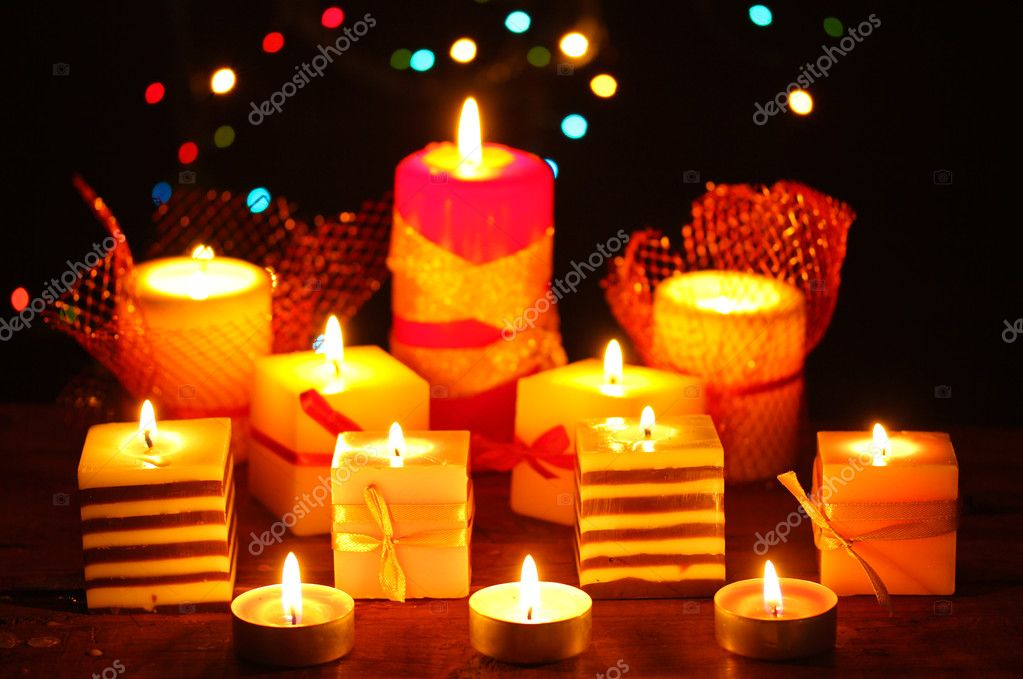 Wonderful candles on wooden table on bright background — Stock Photo #9743602