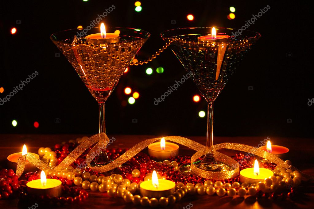 Amazing composition of candles and glasses on wooden table on bright background — Stock Photo #9743608