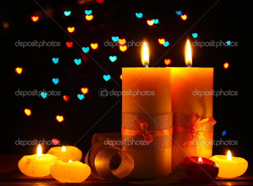 Beautiful candle and decor  on wooden table on bright background  Stock Photo #9743615