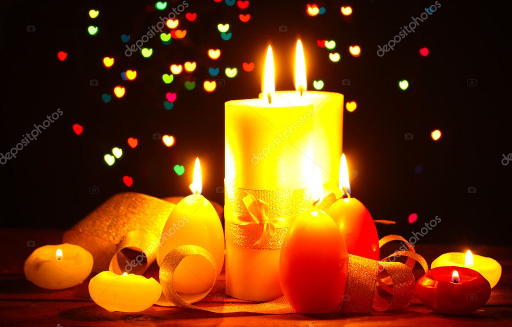 Beautiful candle and decor on wooden table on bright background  Stock Photo #9743616