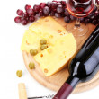 Bottle of great wine with wineglass and cheese isolated on white - Stock Photo