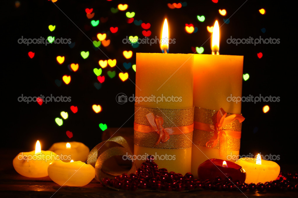 Beautiful candle and decor on wooden table on bright background — Stock Photo #9758128