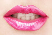 Beautiful make up of glamour pink gloss lips — Stock Photo