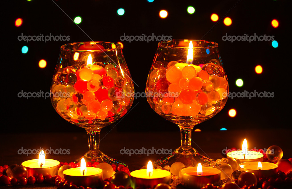 Wonderful composition of candles on wooden table on bright background — Stock Photo #9775922