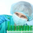 Young female scientist working in chemistry laboratory — Stock Photo