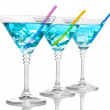 Blue cocktail in martini glasses isolated on white — Stock Photo #9783018