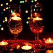 Amazing composition of candles and glasses on wooden table on bright background - Zdjęcie stockowe