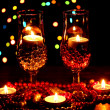 Amazing composition of candles and glasses on wooden table on bright background -  
