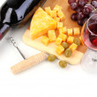 Bottle of great wine with wineglass and cheese isolated on white — Stock Photo #9783681