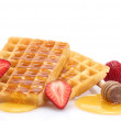 Stock Photo: Belgium waffles with honey and strawberries isolated on white
