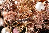 Various gold jewellery closeup — Stock Photo