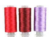 Three bobbin thread isolated on white — Stock Photo