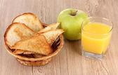 Classical breakfast. Orange juice and toasts — Stock Photo