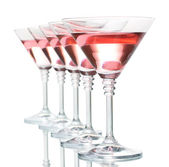 Red cocktail in martini glasses isolated on white — Stock Photo