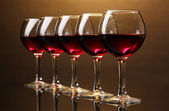 Wineglasses on brown background — Stock Photo