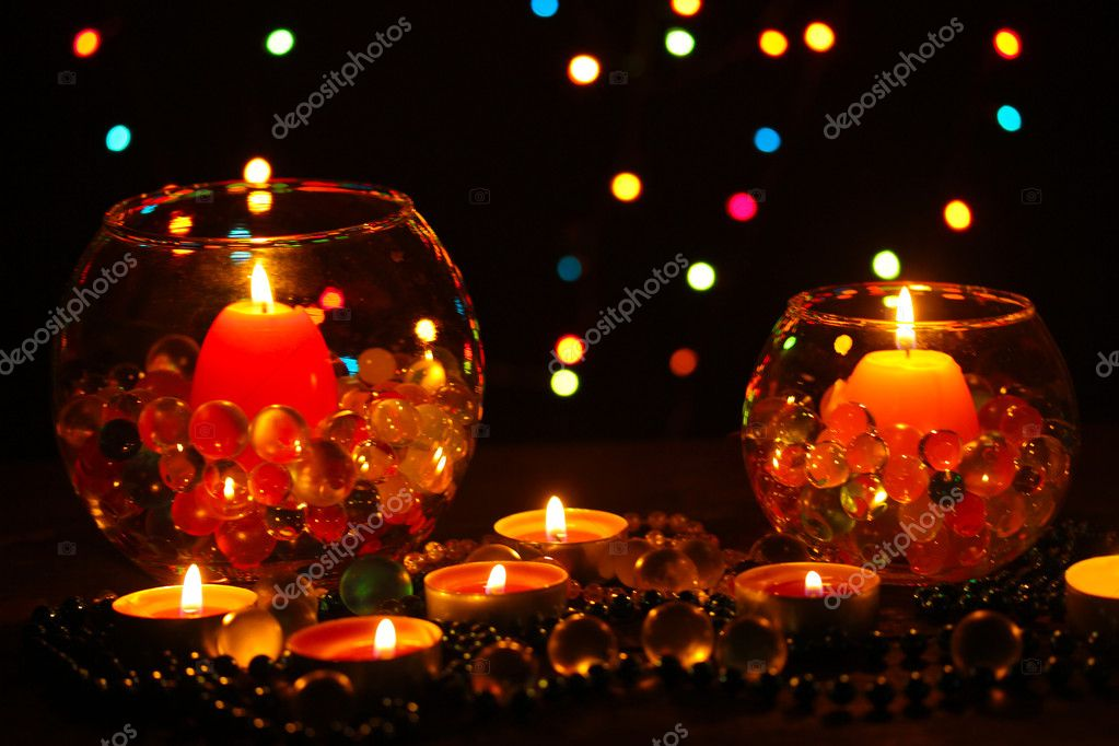 Wonderful composition of candles on wooden table on bright background — Stock Photo #9783596